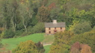 AERIAL Historic cottage preserved for tourists in Minute Man National Historical Park / Massachusetts, United States