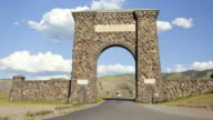 T/L, Historic stone archway entrance into Yellowstone National Park, Montana