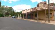 Historic weathered shopfronts in Belubula Street Carcoar NSW including the antique store and the old motor garage that has been made to represent the...