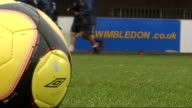 History of Wimbledon Football Club London Kingsmeadow Low angle view of football on pitch with AFC Wimbledon sign in background Erik Samuelson...