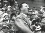 Hitler in SA uniform gesturing speaking MOT 1934 WAITING HD WS Silhouette of male pacing in darkened room MOT 1934 ELDER LEADER President of Germany...