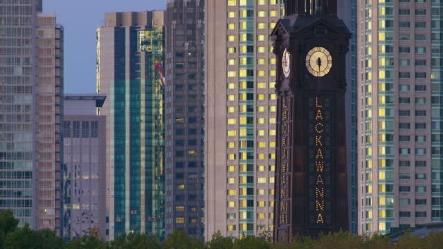 Hoboken clock tower against Jersey City Skyline
