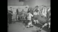 MWS hockey game between Montreal Canadiens and Chicago Blackhawks / MS players inside Canadiens' locker room / MCU Elmer Lach Canadiens' center #16...