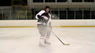 Hockey Player Stopping