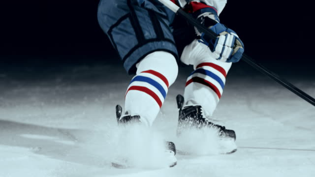 SLO MO Hockey player's skates at stopping