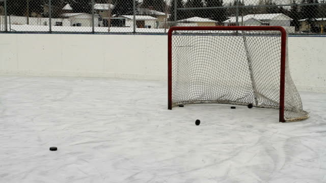 Hockey pucks shot into empty net