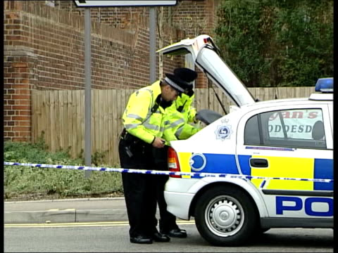 Man shot dead ITN ENGLAND Hertfordshire Hoddesdon Police officer standing guard in road PAN gym outside which man was shot dead seen in distance CMS...