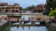 Hoi An, view of a small bridge on the river