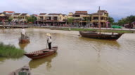 Hoi An, woman with conical hat, rowing on Thu Bon river