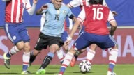 Holders Uruguay made sure of their place in the Copa America quarterfinals here Saturday after battling to a 11 draw with Paraguay in a rematch of...