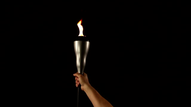 Holding a flaming torch