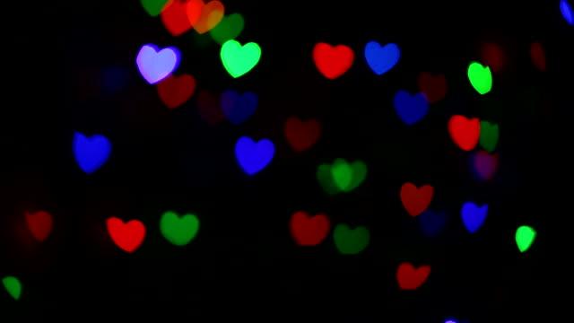 Holiday festliche Herzform bokeh.   Abstrakter Hintergrund Weihnachten und am Valentinstag