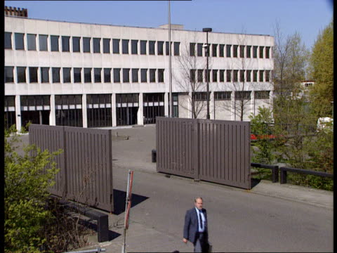 effective prison system ITN HOLLAND Amsterdam EXT GVs prison blocks as canal in f/g / GV prison Amsterdam building / electronically operated doors...