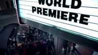 Hollywood couple leaving world premiere walk down red carpet to limousine at awards show