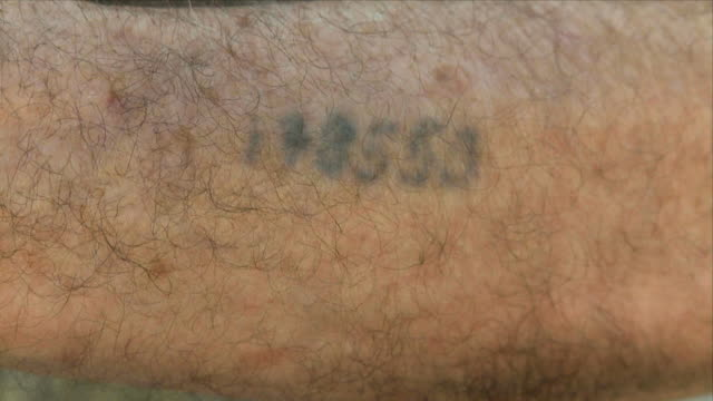 ECU Holocaust survivor showing tattoo on arm / Tel Aviv, Dan metropolitan, Israel
