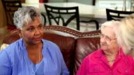 Home healthcare nurse with senior adult patients. Consulation.