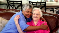 Home healthcare nurse with senior adult patients. Hugs.