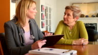 Home Healthcare Professional Using Digital Tablet