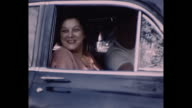1955 Home Movie - Different shots of people with their vintage cars
