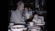 1959 Home Movie  - Grandfather and baby boy at dinner table