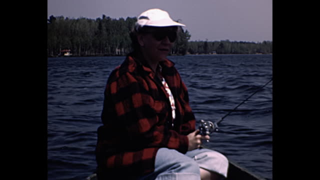 1955 Home Movie - Man and woman fishing in lake