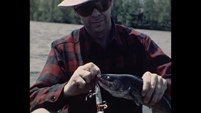 1955 Home Movie - Man killing fish with stick