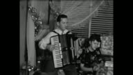 1948 Home Movie - Man plays accordion while Grandparents dance during Christmas Eve family reunion