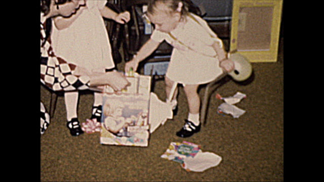 1972 Home Movie of 2 year old girls opening gifts with Mom