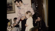 1972 Home Movie of Father cutting birthday cake for guests