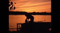 1972 Home Movie - Silhouette of Couple Fishing at Sunset