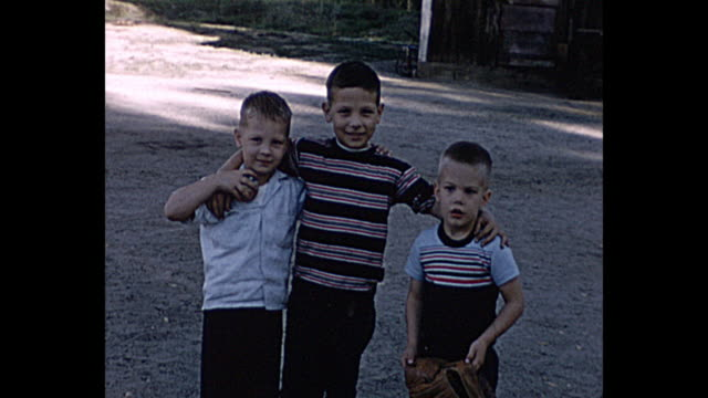 1958 Home Movie Teenage Girl weaves at camera, boys posing for camera after baseball game