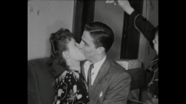 1948 Home Movie - Various clips of couples kissing under the mistletoe