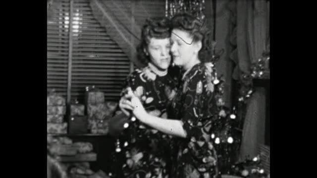 1948 Home Movie - Various shots of twin sisters during Christmas Eve Reunion