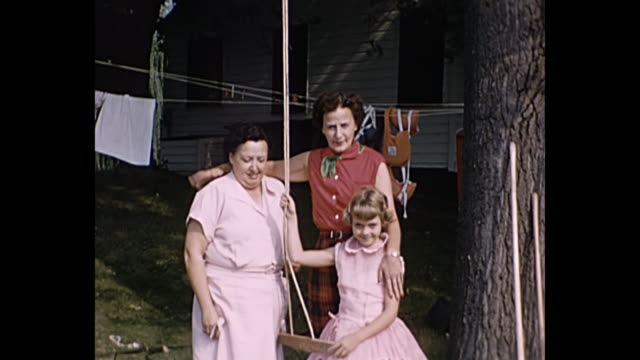 1945 Home Movie - Women with young girl pose for camera
