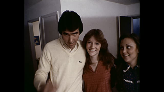 1980 Home Movie Young adults at house party pose for camera