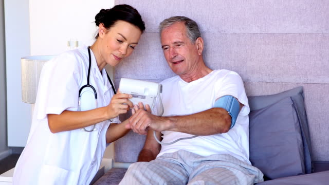 Home nurse pleased with patients blood pressure