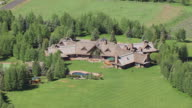 CU AERIAL ZO Home of Arnold Schwarzenegger and pull out to reveal neighbors at Sun Valley / Idaho, United States