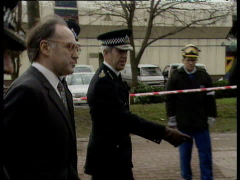 Home Secretary Michael Howard with Metropolitan Police Commissioner Sir Paul Condon and policemen inspecting scene of IRA Docklands Bombing 10 Feb 96
