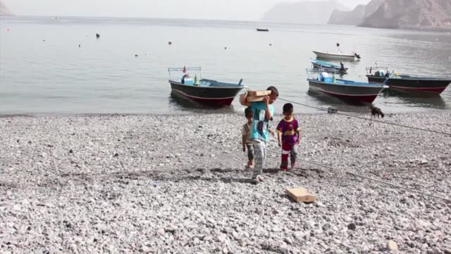 Home to 4000 people and overlooking the strategic Straits of Hormuz that Iran has threatened to close Kumzar village has a thousand yearold language...