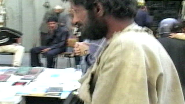 Homeless man in busy Baghdad market on October 15 2005 in Baghdad Iraq
