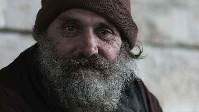 homeless man looking at the camera