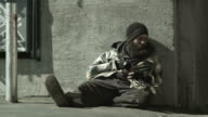 WS Homeless man sitting on street, Salt Lake City, Utah, USA