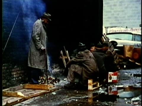 MONTAGE, Homeless men on street, 1960's, Detroit, Michigan, USA