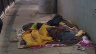 WGN Homeless people sleeping under bridge on Lower Wacker on December 24 2013 in Chicago Illinois