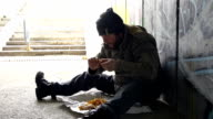 HD DOLLY: Homeless Person Eating Food
