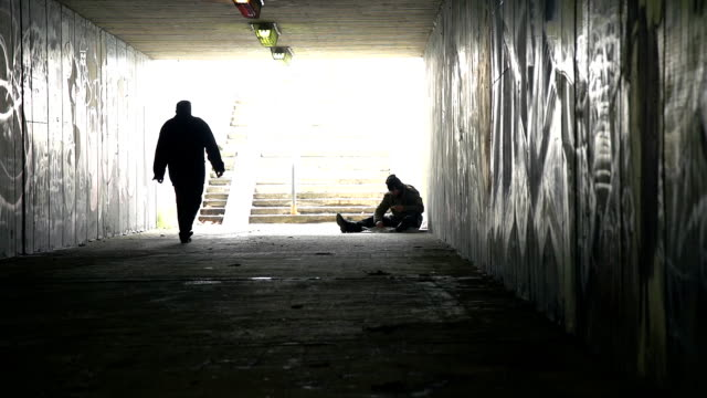 HD DOLLY: Homeless Person Eating In An Underpass