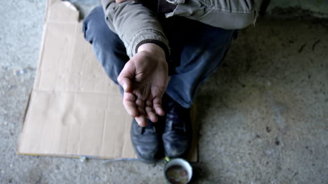 HD DOLLY: Homeless Person Holding An Open Hand