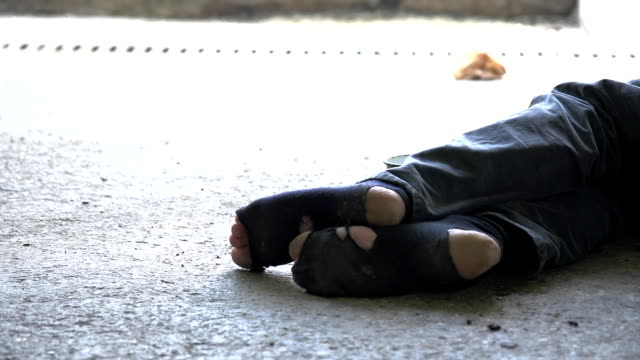 HD DOLLY: Homeless Person Sleeping Beside His Cup