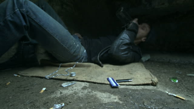 HD DOLLY: Homeless Young Man Drinking Alcohol