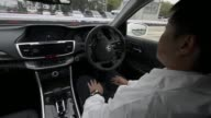 A Honda Motor Co Accord hybrid sedan equipped with an automatic driving system is demonstrated at the ITS Word Congress Tokyo 2013 in Tokyo Japan on...